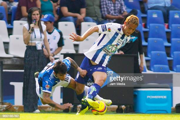 Edson Puch of Queretaro and Keisuke Honda of Pachuca fight for the ball during the 16th round match between Queretaro and Pachuca as part of the...