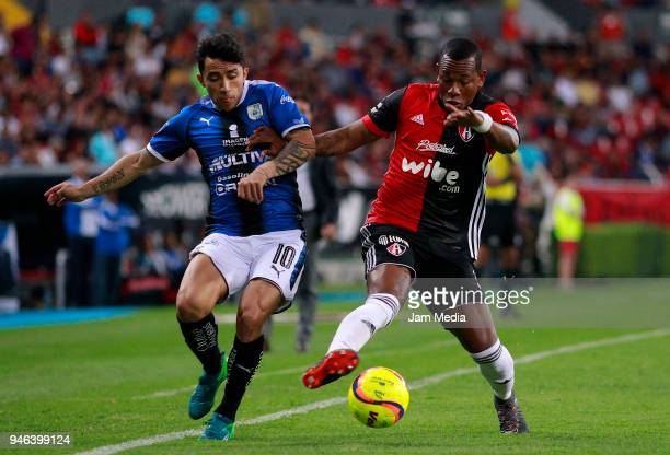 Edson Puch of Queretaro and Leiton Jimenez of Atlas fight for the ball during the 15th round match between Atlas and Queretaro at Estadio Jalisco on...