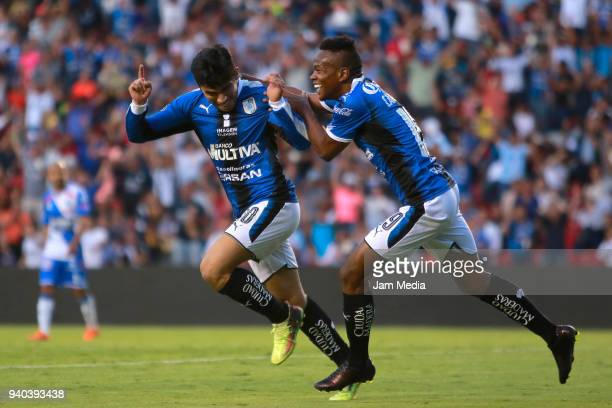 Edson Puch of Queretaro celebrates with teammate Yerson Candelo after scoring his team´s second goal during the 13th round match between Queretaro...
