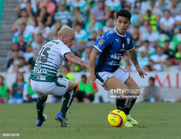 Edson Puch of Queretaro fights for the ball with Bryan Lozano of Santos during the 14th round match between Santos Laguna and Querataro as part of...
