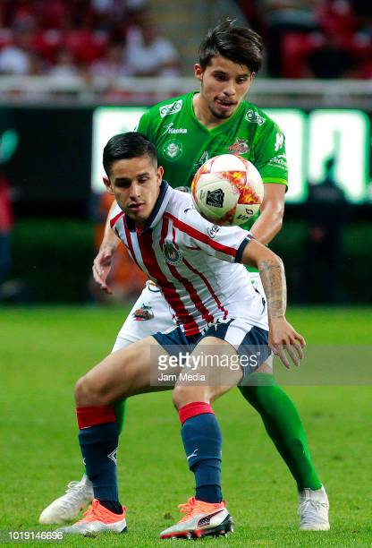 Miguel Jimenez goalkeeper of Chivas fights for the ball with Vladimir Moragrega of Alebrijes during a match between Chivas and Alebrijes as part of...