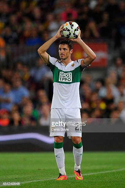 Edu Albacar of Elche CF in action during the La Liga match between FC Barcelona and Elche FC at Camp Nou stadium on August 24 2014 in Barcelona Spain