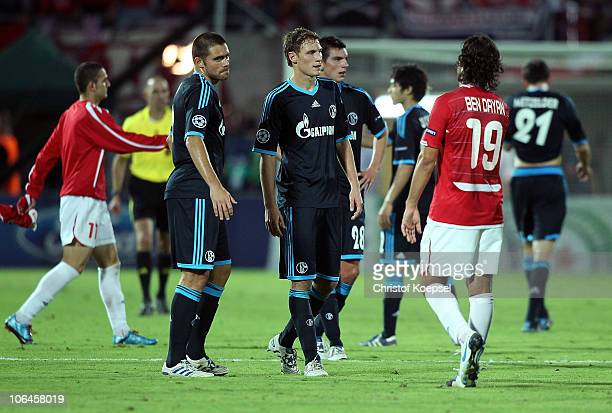 Edu Benedikt Hoewedes of Schalke and Christoph Moritz of Schalke look dejected after the 00 draw of the UEFA Champions League group B match between...