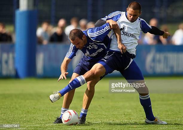 Edu challenges Christoph Metzelder of Schalke during the FC Schalke training session at the training ground on August 5, 2010 in Gelsenkirchen,...