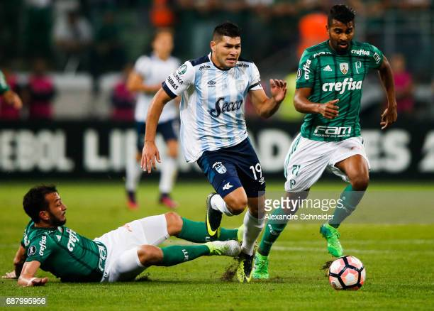 Edu Dracena and Thiago Santos of Palmeiras of Brazil and David Barbona of Atletico Tucuman and in action during the match between Palmeiras and...