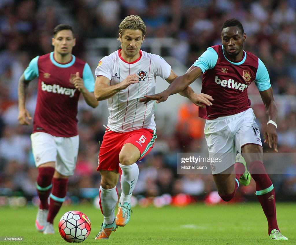 Edu Moya of FC Lusitans and Diafra Sakho of West Ham compete for the ball during the UEFA Europa League match between West Ham United and FC Lusitans at Boleyn Ground on July 2, 2015 in London, England.