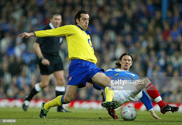 Edu of Arsenal is tackled by Alexei Smertin of Portsmouth during the FA Cup Quarter Final match between Portsmouth and Arsenal at Fratton Park on...