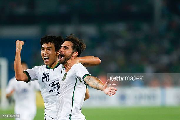 Edu of Jeonbuk Hyundai Motors celebrates with team mate Lee Donggook after scoring his team's first goal during the AFC Champions League Round of 16...