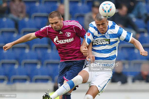 Edu of Schalke and Bruno Soares of Duisburg head for the ball during the Loveparade charity match between MSV Duisburg and FC Schalke 04 at the...