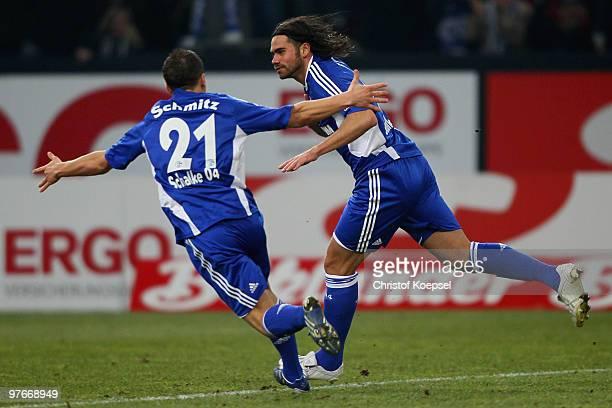 Edu of Schalke celebrates his team's first goal with team mate Lukas Schmitz of Schalke during the Bundesliga match between FC Schalke 04 and VfB...