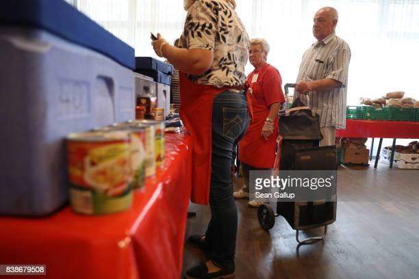 Eduard a retired truck and machine driver chooses groceries at a food distribution point organized by the Berliner Tafel at the Protestant Church...