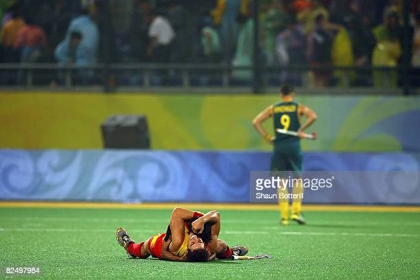 Eduard Arbos of Spain and teammate celebrate winning 32 over Australia in the men's semifinal match held at the Olympic Green Hockey Field during Day...