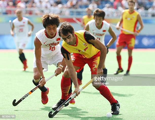 Eduard Arbos of Spain competes against Li Wei of China in the Men's Pool MA Match M13 between Spain and China at the Olympic Green Hockey Field on...