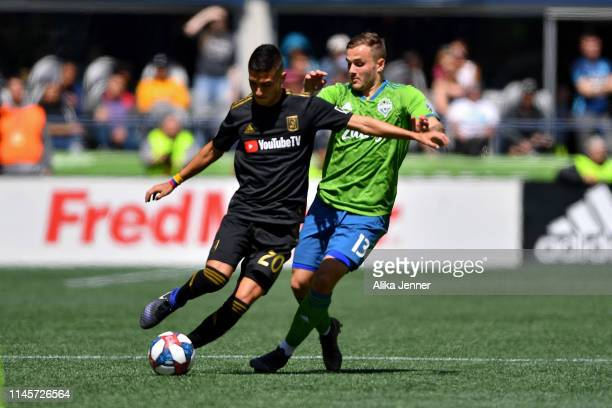 Eduard Atuesta of the Los Angeles FC gets around Jordan Morris of the Seattle Sounders during the second half pf the match at CenturyLink Field on...