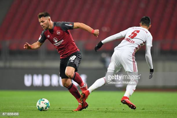 Eduard Loewen  of 1FC Nuernberg and Alfredo Morales of FC Ingolstadt 04 compete for the ball during the Second Bundesliga match between 1 FC...