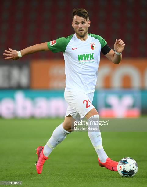 Eduard Loewen of Augsburg controls the ball during the Bundesliga match between FC Augsburg and SC Paderborn 07 at WWKArena on May 27 2020 in...