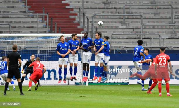 Eduard Loewen of Augsburg scores his sides first goal during the Bundesliga match between FC Schalke 04 and FC Augsburg at VeltinsArena on May 24...