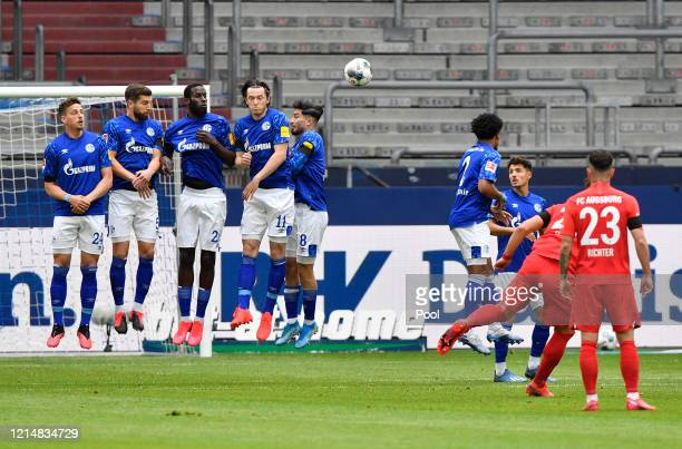 Eduard Loewen of Augsburg scores his sides first goal during the Bundesliga match between FC Schalke 04 and FC Augsburg at Veltins-Arena on May 24,...