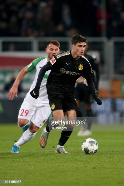 Eduard Loewen of FC Augsburg and Giovanni Reyna of Borussia Dortmund battle for the ball during the Bundesliga match between FC Augsburg and Borussia...