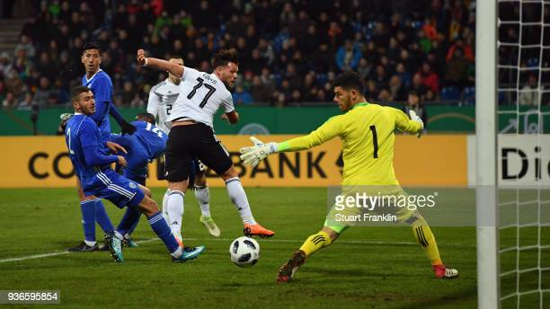 Eduard Loewen of Germany scores his team's first goal past goalkeeper Omri Glazer of Israel during the 2019 UEFA Under21 European Championship...