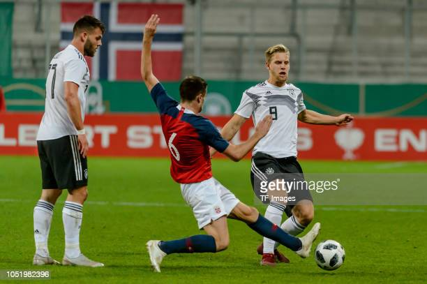 Eduard Loewen of Germany Vebjoern Hoff of Norway and Arne Maier of Germany battle for the ball during the 2019 UEFA Under21 European Championship...
