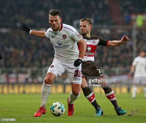 Eduard Loewen of Nuernberg and Bernd Nehrig of St Pauli battle for the ball during the Second Bundesliga match between FC St Pauli and 1 FC Nuernberg...
