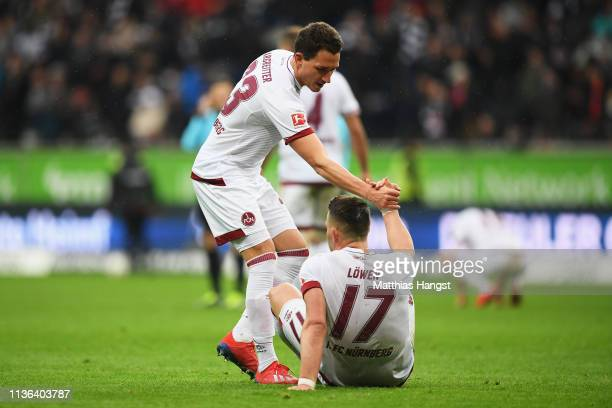 Eduard Lowen and Georg Margreitter of Nurnberg looks dejected after the Bundesliga match between Eintracht Frankfurt and 1 FC Nuernberg at...
