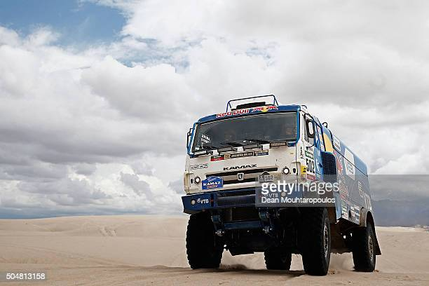 Eduard Nikolaev of Russia Vladimir Rybakov of Russia and Evgeny Yakovlev of Russia of KAMAZ MASTER and in truck KAMAZ 4326 compete on day 11 stage...
