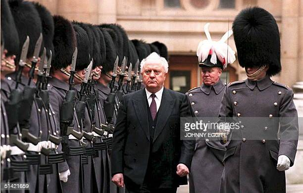 Eduard Shevardnadze head of state for the Georgian Republic inspects a guard of honor of the 1st Battalion of Irish Guards 15 February upon arrival...