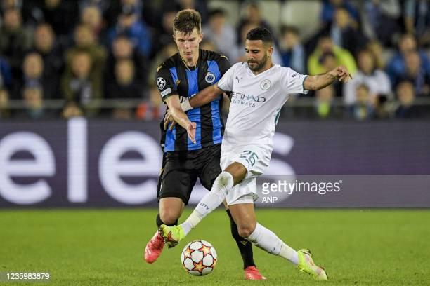 Eduard Sobol of Club Brugge, Riyad Mahrez of Manchester City FC during the UEFA Champions League match between Club Brugge and Manchester City FC at...