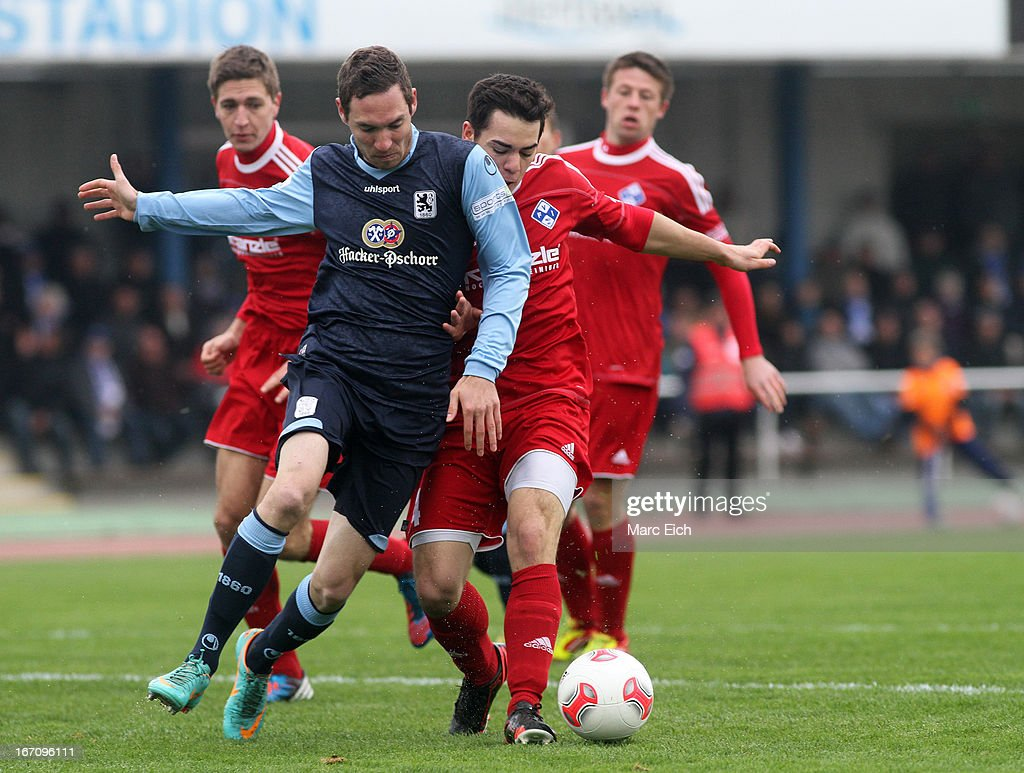 Eduard Thommy of Illertissen (R) challenges Markus Ziereis of Muenchen (L) during the Regionalliga Bayern match between FV Illertissen and 1860 Muenchen II at Voehlinstadion on April 20, 2013 in Illertissen, Germany.