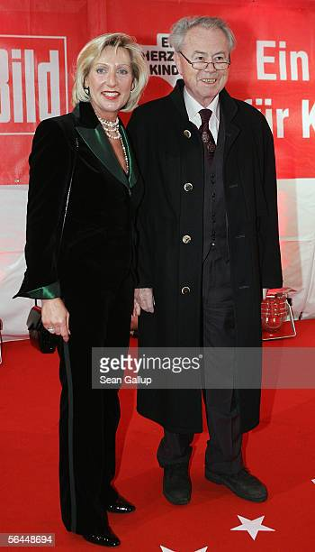 """Eduard Zimmermann with guest arrive at the """"Ein Herz Fuer Kinder"""" television charity gala at the Axel Springer December 17, 2005 in Berlin, Germany."""