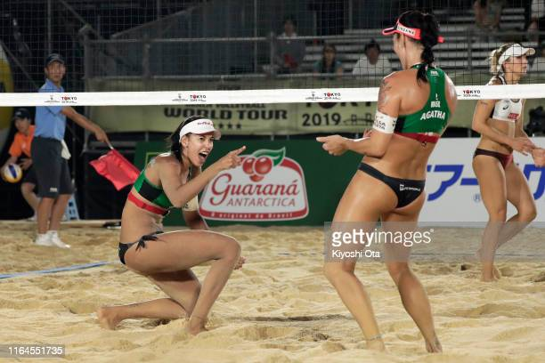 """Eduarda """"Duda"""" Lisboa and Agatha Bednarczuk of Brazil react in the Women's semifinal match against Heather Bansley and Brandie Wilkerson of Canada on..."""