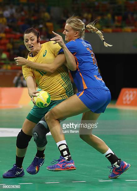 Eduarda Taleska of Brazil is challenged by Kelly Dulfer of Netherlands during he Womens Quarterfinal match between Brazil and Netherlands on Day 11...