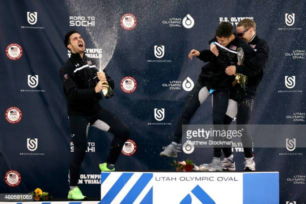 Eduardo Alvarez JR Celski and Jordan Malone celebrate on the medals podium after the men's 500 meter during the US Olympic Short Track Trials at the...