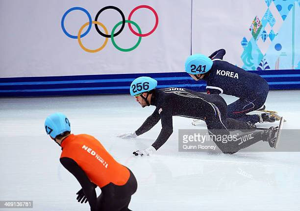 Eduardo Alvarez of the United States and HoSuk Lee of South Korea clash and fall as they compete in the Short Track Speed Skating Men's 5000m Relay...