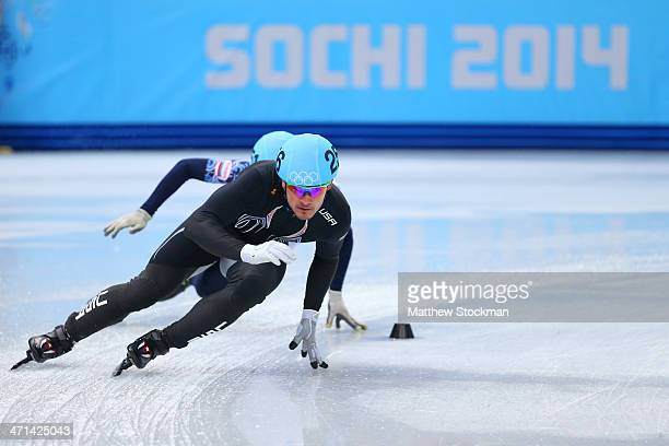 Eduardo Alvarez of the United States competes in the Short Track Men's 5000m Relay A on day fourteen of the 2014 Sochi Winter Olympics at Iceberg...