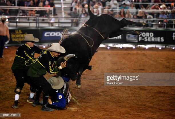 Eduardo Aparecido is charged by Midnight Rock during the PBR Unleash The Beast bull riding event at Okeechobee Agri-Civic Center on January 31, 2021...