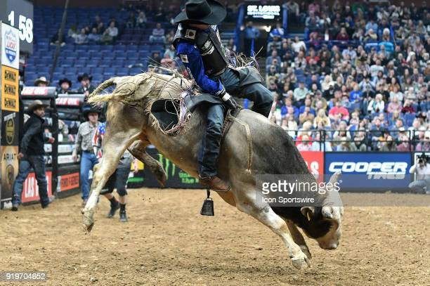 Eduardo Aparecido rides the bull Johnny Ringo during round one of the Professional Bull Riders St Louis Invitational on February 17 at Scottrade...