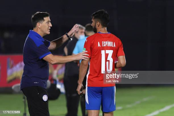 Eduardo Berizzo head coach of Paraguay gives instructions to Alberto Espinola of Paraguay during a match between Paraguay and Peru as part of South...