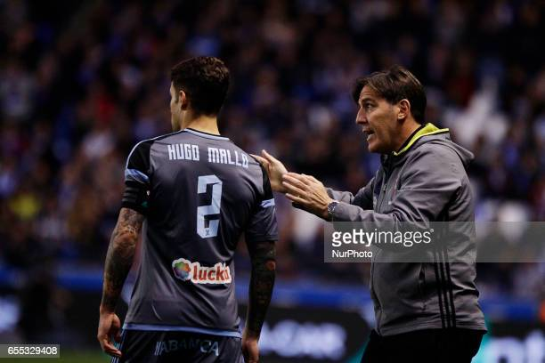 Eduardo Berizzo manager of Celta de Vigo talks with Hugo Mallo defender of Celta de Vigo during the La Liga Santander match between Deportivo de La...