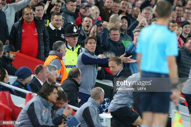 Eduardo Berizzo the coach of Sevilla FC is sent off by referee Danny Makkelie during the UEFA Champions League group E match between Liverpool FC and...