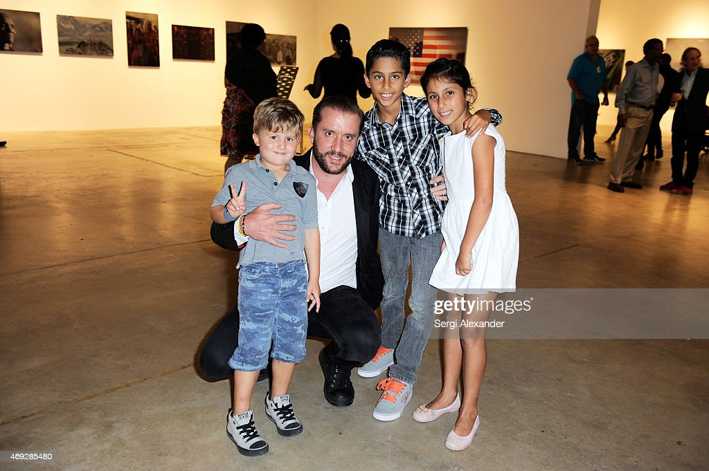 Eduardo Burillo (2nd left ) attends Andrew Levitas Metalwork Playground opening reception at Blueshift Wynwood on April 10, 2015 in Miami, Florida.
