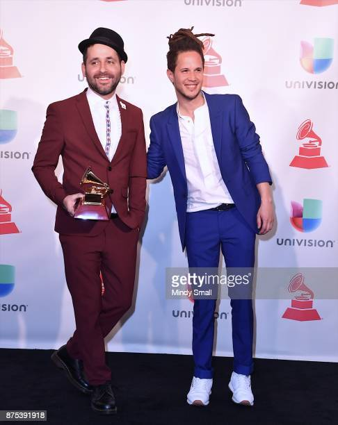 Eduardo Cabra and Vicente Garcia pose with the award for Producer of the Year in the press room during The 18th Annual Latin Grammy Awards at MGM...