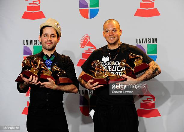 Eduardo Cabra Martinez aka Vistante and Rene Perez Joglar aka Residente of the musical group Calle 13 pose in the press room with their multiple...