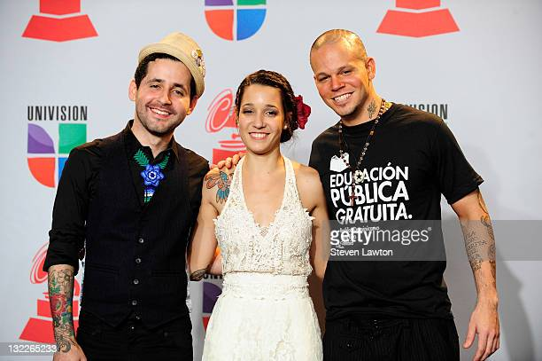 Eduardo Cabra Martinez aka Vistante Ileana Cabra Joglar and Rene Perez Joglar aka Residente of the musical group Calle 13 pose in the press room with...