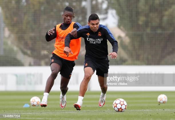 Eduardo Camavinga and Carlos Casemiro of Real Madrid are training at Valdebebas training ground on October 16, 2021 in Madrid, Spain.