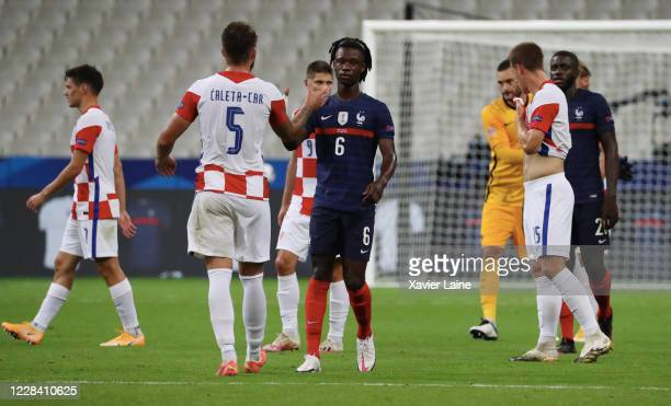 Eduardo Camavinga of France reacts with Crotian players after the UEFA Nations League group stage match between France and Croatia at Stade de France...