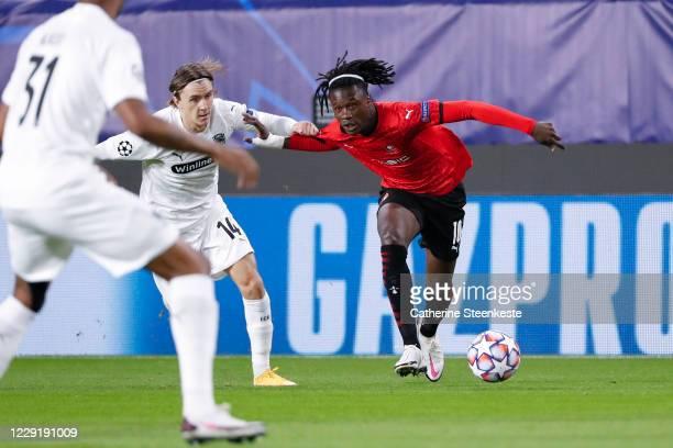 Eduardo Camavinga of Stade Rennais FC tries to control the ball against Kristoffer Olsson of FC Krasnodar during the UEFA Champions League Group E...