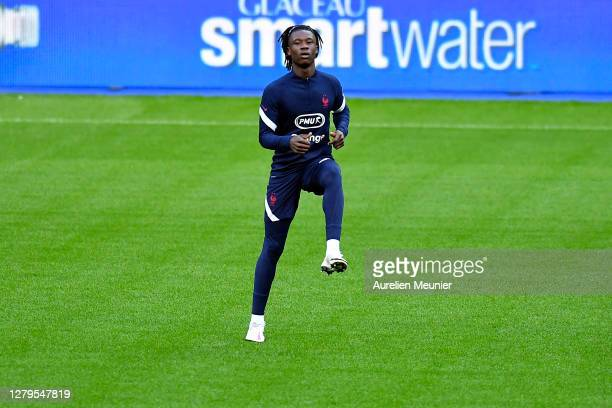 Eduardo Camavinga warms up during a France soccer team training session at Stade de France on October 10, 2020 in Paris, France.